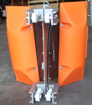 Tidal compensator by GEI Works allows boom or barrier to raise or lower with the tide